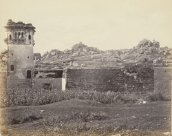 Ruins of Vijianuggur [Vijayanagara]. near Calamapoor [Kamalapuram]. [General view of ruins, with square watchtower.]